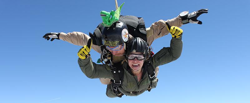 A woman enjoying tandem freefall