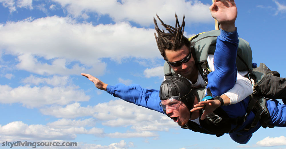 Man making a perfect tandem jump
